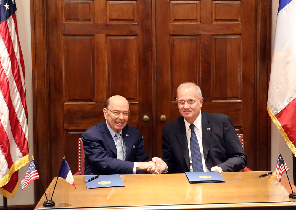 Secretary of Commerce Wilbur Ross and CNES President Jean-Yves Le Gall shake hands